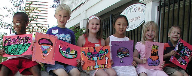 photo of six children holding up their artwork of ice cream bowls