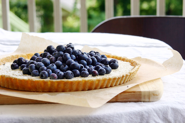 blueberry ricotta tart on table