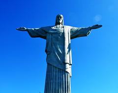 O Cristo Redentor é um monumento de Jesus Cristo localizado na cidade do Rio de Janeiro, Brasil. Está localizado no topo do Morro do Corcovado, a 709 metros acima do nível do mar. Foi inaugurado às 19h 15min do dia 12 de outubro de 1931, depois de cerca de cinco anos de obras. Um símbolo do Cristianismo, o monumento tornou-se um dos ícones mais reconhecidos internacionalmente do Rio e do Brasil. No dia 7 de julho de 2007, em Lisboa, no estádio da Luz, foi eleito uma das novas sete maravilhas do mundo. Dos seus 38 metros, oito estão no pedestal e 30 na estátua, a qual é a segunda maior escultura de Cristo no mundo, atrás apenas da Estátua de Cristo Rei.  Em uma pesquisa realizada pela revista América Economia, no ano de 2011, o Cristo Redentor foi considerado por 23,5% dos entrevistados como o maior símbolo da América Latina. A pesquisa foi feita pela internet e reuniu a opinião de 1 734 executivos de todos os países da região.   Christ the Redeemer (Portuguese: Cristo Redentor) is a statue of Jesus Christ in Rio de Janeiro, Brazil; considered the second largest Art Deco statue in the world.[1][2] It is 39.6 metres (130 ft) tall, including its 9.5 metres (31 ft) pedestal, and 30 metres (98 ft) wide. It weighs 635 tonnes (625 long,700 short tons), and is located at the peak of the 700-metre (2,300 ft) Corcovado mountain in the Tijuca Forest National Park overlooking the city. A symbol of Christianity, the statue has become an icon of Rio and Brazil.[3] It is made of reinforced concrete and soapstone, and was constructed between 1922 and 1931.  La estatua Cristo Redentor o Cristo de Corcovado está situada a 709 metros sobre el nivel del mar, en la ciudad de Río de Janeiro, Brasil, específicamente en la cima del cerro del Corcovado. Tiene una altura total de treinta metros. Fue inaugurado el 12 de octubre de 1931, después de aproximadamente cinco años de obras.   コルコバードのキリスト像(コルコバードのキリストぞう、ブラジルポルトガル語:Cristo Redentor、クリスト・ヘデントール)は、ブラジルのリオデジャネイロのコルコバードの丘にある、巨大なキリスト像。 1931