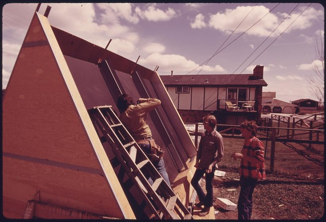 DOCUMERICA: Backyard solar heating system being installed at a home..., 05/1975 by Boyd Norton.