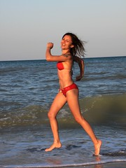Happy-Woman-Running-in-Water-on-the-Beach__51742