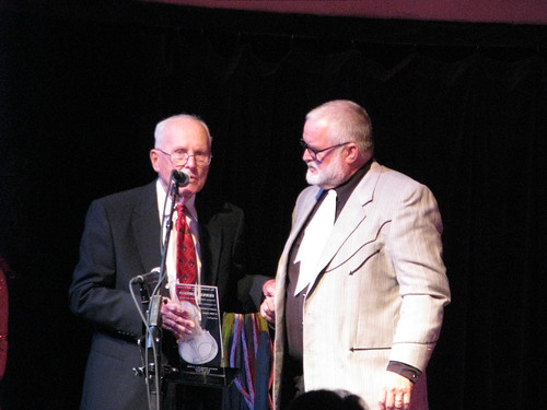 Herman Johnson inducted into the National Fiddler Hall of Fame, with NFHOF board member Bob Fjeldsted, MDB21758 by Michael Bates, on Flickr