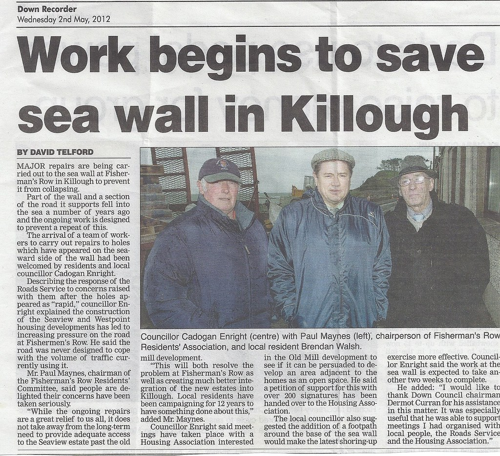 Cllr Cadogan Enright (centre) with local residents at the Sea Wall at Fishermans Row in Killough