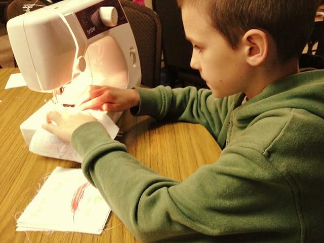 skyler sewing quilt squares