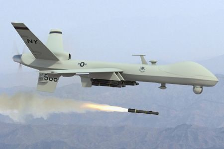 US predator drone unleashing the hellfire missile. This weapon deployed by the Central Intelligence Agency (CIA) and the Pentagon has killed thousands. The Obama administration has increased its usage in Africa, the Middle East and Central Asia.