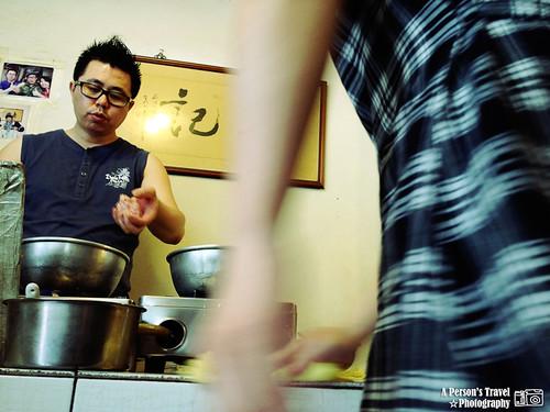 煮廣東粥的老闆