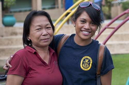 Seaman Joy Bonnett embraces one of her former caregivers during a community service event.