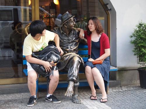 Prague bench + tourist