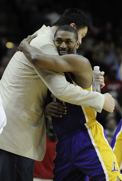 March 20th, 2012 - Yao Ming and former teammate Metta World Peace hug each other before the Rockets-Lakers game