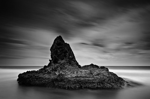 longexposure sea newzealand sky blackandwhite water monochrome rock clouds island coast nikon surf auckland filter northisland westcoast bethellsbeach nd110