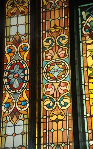 Detail pf panels, brightly colored stained glass window, 4th of July, night, Elgin, Illinois, USA by Wonderlane