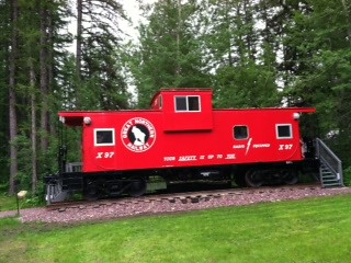 Preserved former Great Northern Railway wide vision caboose at The Izaak Walton Inn.  Glacier National Park.  Montana USA. by Eddie from Chicago