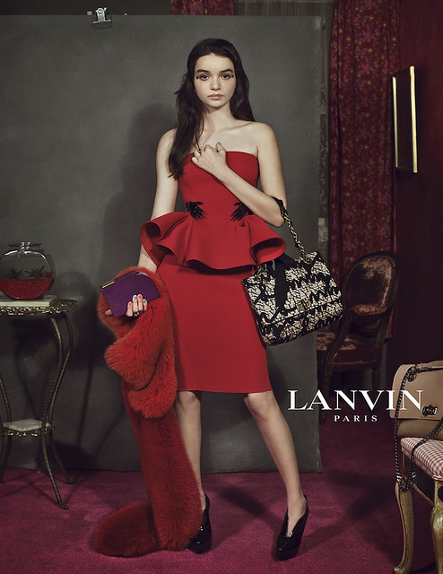 lanvin red peplum dress with tiny hands -- elle september 2012