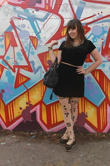 Black and tan outfit: thrifed 1990s black velvet mini dress, Jeffrey Campbell flatforms, American Apparel punctuation tights, leopard print horse-hair belt, studded-bottom belt, Peter-Pan collar necklace
