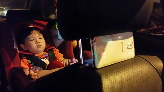 Jerome choo in his car seat.
