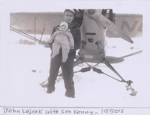 John and his son Kenny in front of his plane, 1950s.