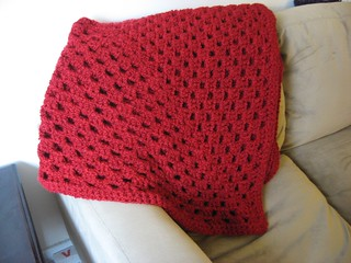 red granny square throw folded