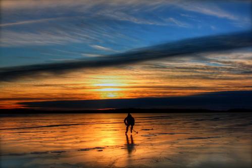 blue light sunset lake reflection ice hockey minnesota yellow clouds frozen north reflect skate stick