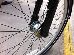 automotive tire(0.0), tire(1.0), road bicycle(1.0), wheel(1.0), vehicle(1.0), rim(1.0), land vehicle(1.0), bicycle wheel(1.0), bicycle frame(1.0), bicycle(1.0), spoke(1.0), tarmac(1.0),