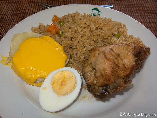 Arroz con pollo with potatoes Huancaina (the name of the yellow sauce)