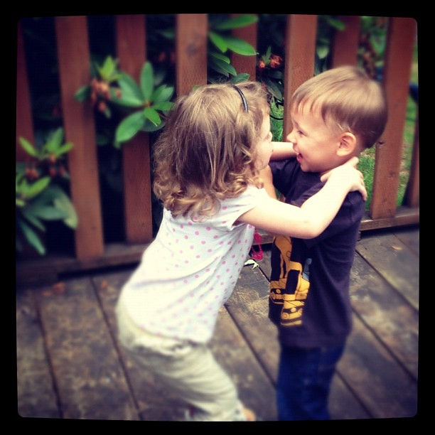 Kissing cousins! No, she is NOT choking him, contrary to how it looks.