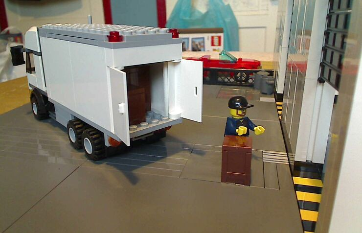 Small lorry outside a LEGO® model of a warehouse