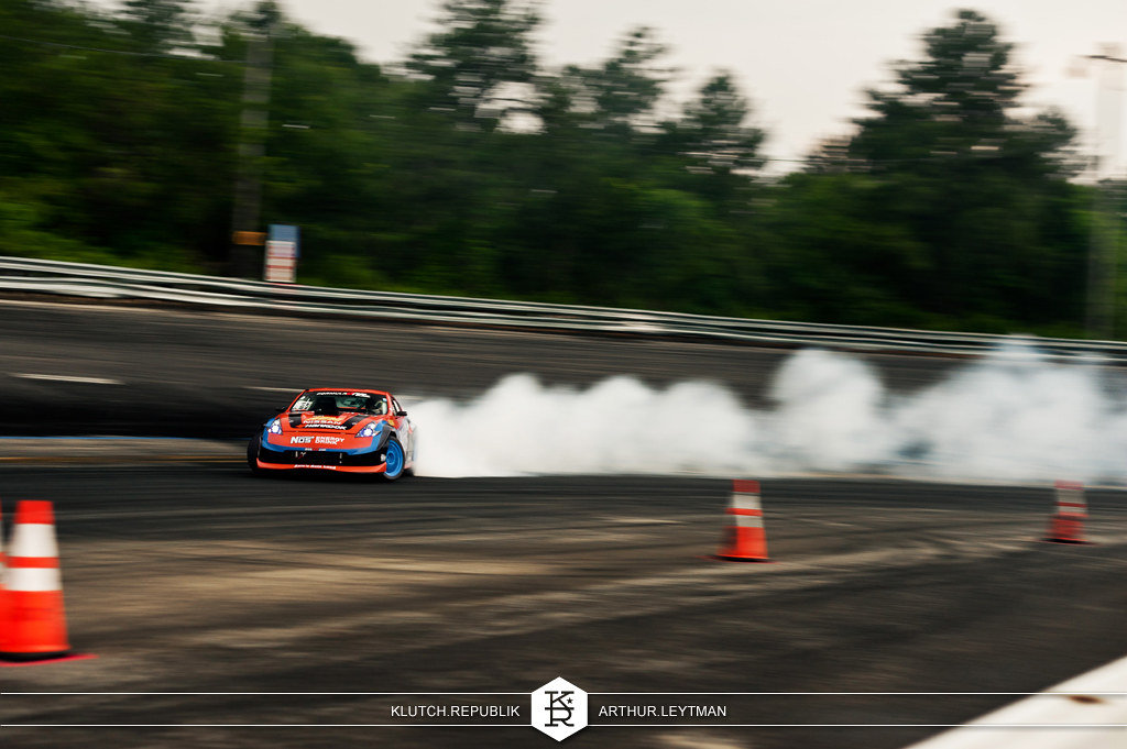 orange black NOS energy drink nissan 370z drifting at formula drift the wall new jersey 3pc wheels static airride low slammed coilovers stance stanced hellaflush poke tuck negative postive camber fitment fitted tire stretch laid out hard parked seen on klutch republik