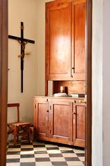 hall(0.0), bathroom cabinet(0.0), door(0.0), bathroom(0.0), floor(1.0), furniture(1.0), wood(1.0), room(1.0), cupboard(1.0), interior design(1.0), hardwood(1.0), cabinetry(1.0), home(1.0), flooring(1.0), lighting(1.0),