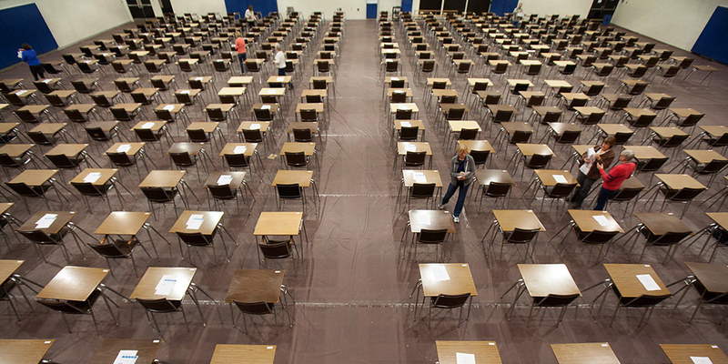 Exam proctors arrive early in the morning to prepare Bartlett Gymnasium before hundreds of students fill the room to write their final exams.