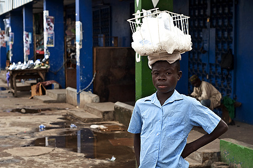 Boy selling water at Makola market