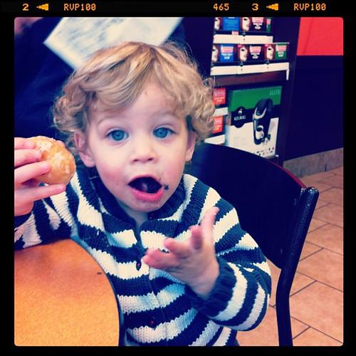 Littlest enjoying his donut hole