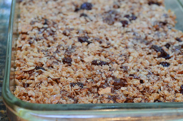 Granola bars resting in pan after baking.