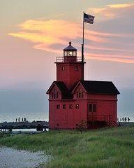 """Big Red""  Holland Harbor Lighthouse Sunset - Holland, Michigan by Michigan Nut"