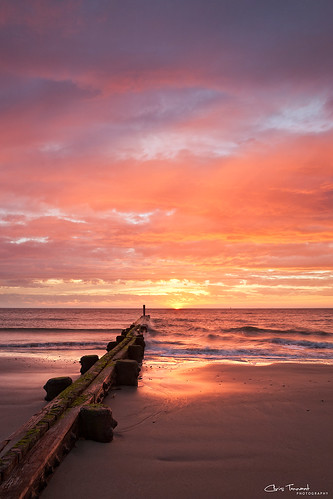 ocean beach water clouds sunrise dawn virginia waves dramatic shore va hamptonroads buckroe christennantphotography