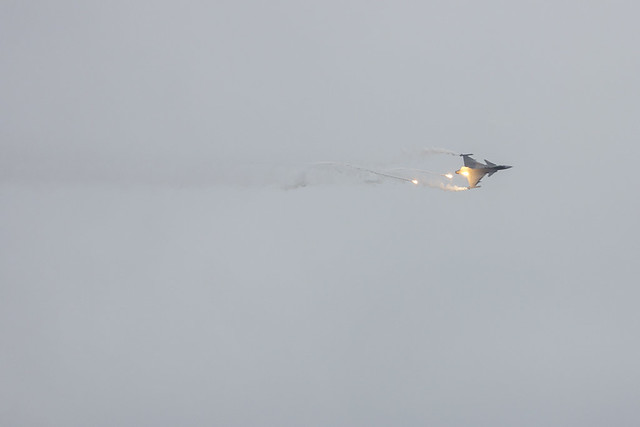 Saab JAS39C Gripen launching flares while in barrel roll.