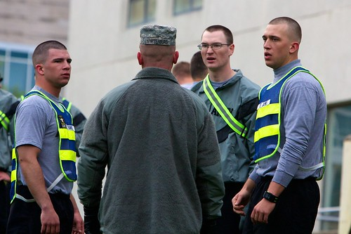 Robert Whittenburg, IU Kokomo assistant professor of military science, instructions cadets Tyler Burke, left; Aaron Bird and Brady James during physical training on campus.