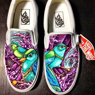 Finally finished this pair of slip-on Vans for a friend. #handpainted #custom #vans #dmise #acrylics #birds #bling #baller #waves #artsy #funky