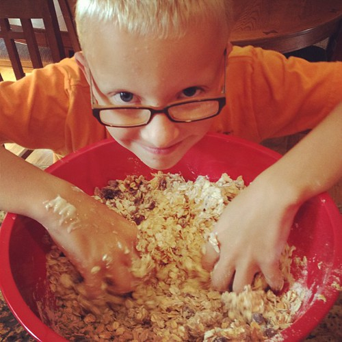 JPAD- July photo a day- (I'm abbreviating it now): 12: Texture. Josh making home made granola bars. Lots of delicious texture in that bowl!