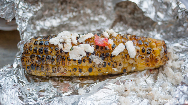 Grilled corn with cheese, chili, lime