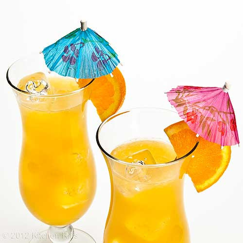 Fog Cutter Cocktails with Orange Garnish and Umbrellas