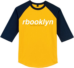orange(0.0), sports fan jersey(0.0), sports uniform(0.0), long-sleeved t-shirt(0.0), brand(0.0), active shirt(1.0), clothing(1.0), yellow(1.0), sleeve(1.0), font(1.0), jersey(1.0), sportswear(1.0), shirt(1.0), t-shirt(1.0),