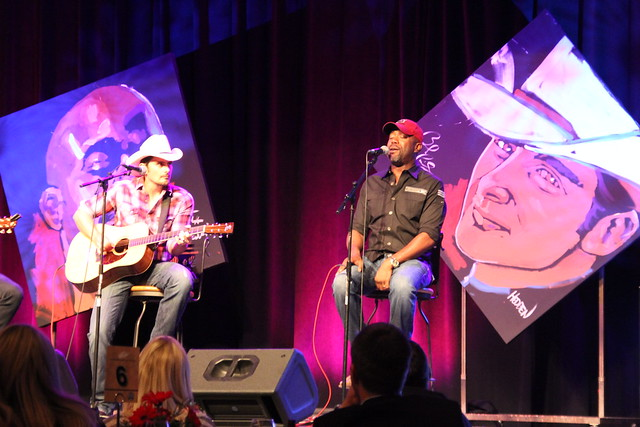 Brad Paisley and Darius Rucker play at a NASCAR charity event