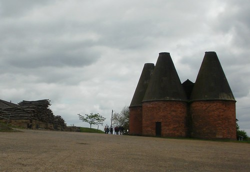 Woodpile and old oast house