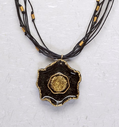 pendant made of paper pulp in black and gold with glossy coating