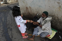 Marziya gives alms to the muslim beggar by firoze shakir photographerno1
