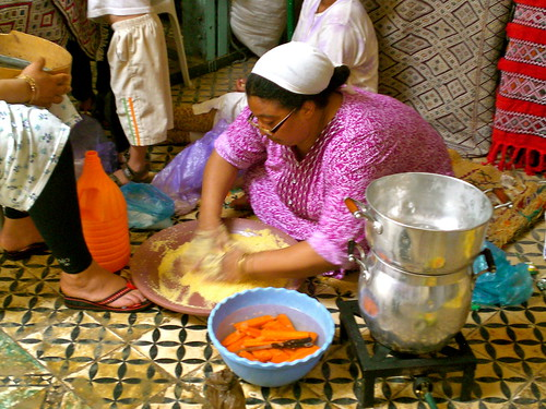 Khadija rolls her own cous cous from semolina, white flour, and salt.