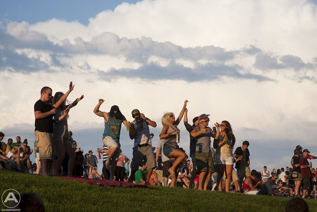 Revellers enjoy the sunset on the lawn