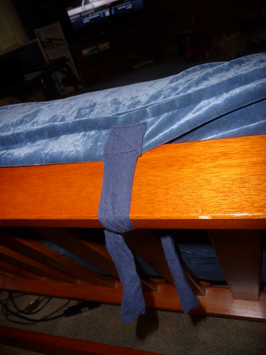 Tie around top of futon bas