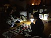 Checkers by lamp light