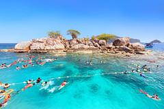 Tourists are enjoy snorkeling underwater at Koh Yak Lek (Island near Koh Chang in Trat, Thailand)